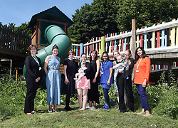 Samantha Cameron (miidle) hosts a coffee morning to celebrate the work of charity KIDS and the services that they deliver to disabled children, young people and their families, at Hackney Adventure Playground in London.