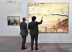 © Licensed to London News Pictures. 07/10/2011. LONDON. UK. Two men look at Peter Doig's Bellevarde of 1995 at a Sotheby's Preview.  The piece will be sold at auction on October 13 2011 and is expected to fetch £1.5-2million. Photo credit:  Stephen Simpson/LNP