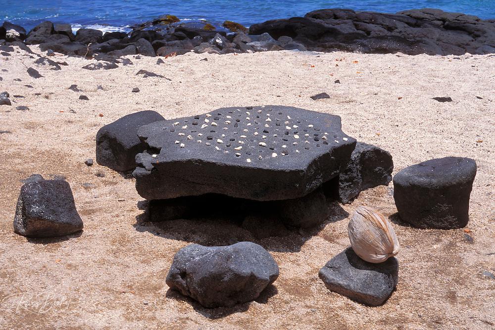 Konane stone (ancient Hawaiian game) at Pu'uhonua O Honaunau National Historic Park (City of Refuge), Kona Coast, The Big Island, Hawaii