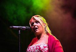 © Licensed to London News Pictures.22/08/15<br /> Castle Howard, North Yorkshire, UK. <br /> <br /> Vocalist Rebecca Newman performs for hundreds of people attending the 25th anniversary of the Castle Howard Proms event near York. The theme of the event this year is a commemoration of the 75th anniversary of the Battle of Britain and the 70th anniversary of VE day and brings an evening of classic musical favourites celebrating Britishness to the lawns of Castle Howard.<br /> <br /> Photo credit : Ian Forsyth/LNP
