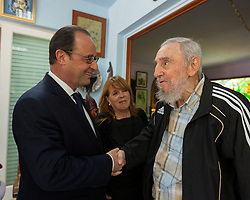 File photo : Handout picture of French President Francois Hollande shaking hands with Cuban historical leader Fidel Castro during a meeting in Havana, Cuba, on May 11, 2015. Hollande's Cuba trip, the first ever by a French leader, has highlighted the simultaneously cooperative and competitive relationship between the United States and the European Union as both look to increase business with Havana. Photo via ABACAPRESS.COM