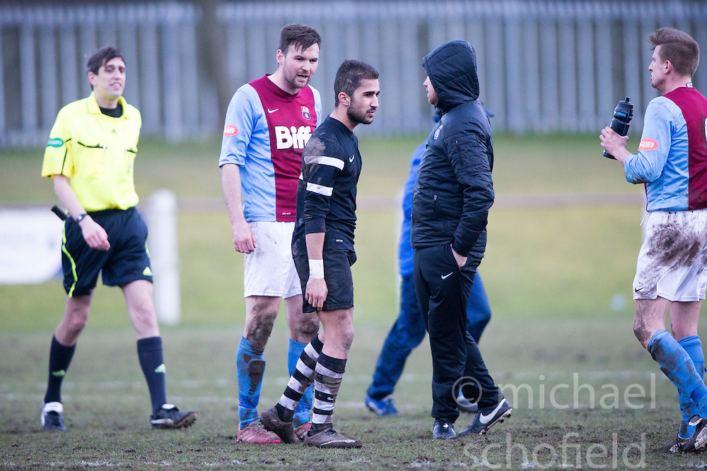 Whitehill Welfare Andrew Kidd and Edusport Academy Yassine Fartassi at the end.<br /> Whitehill Welfare 2 v 1 Edusport Academy, South Challenge Cup Quarter Final played 7/3/2015 at Ferguson Park, Carnethie Street, Rosewell.