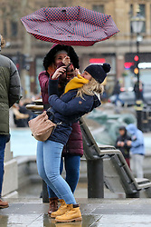 © Licensed to London News Pictures. 15/02/2020. London, UK. A woman struggles to control her umbrella in Trafalgar Square during wet and windy weather as Storm Dennis arrives in London. Heavy rain and strong winds are forecast from today until Monday 17 February as the Storm Dennis sweeps across the UK with heavy rain, gale force winds and flooding. Photo credit: Dinendra Haria/LNP