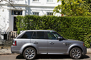 Range Rover SUV parked in an exclusive residential street scene in Kensington. In a selected few boroughs of West London, wealth has changed over the last couple of decades. Traditionally wealthy parts of town, have developed into new affluent playgrounds of the super rich. With influxes of foreign money in particular from the Middle-East. The UK capital is home to more multimillionaires than any other city in the world according to recent figures. Boasting a staggering 4,224 'ultra-high net worth' residents - people with a net worth of more than $30million, or £19.2million.. London, England, UK.