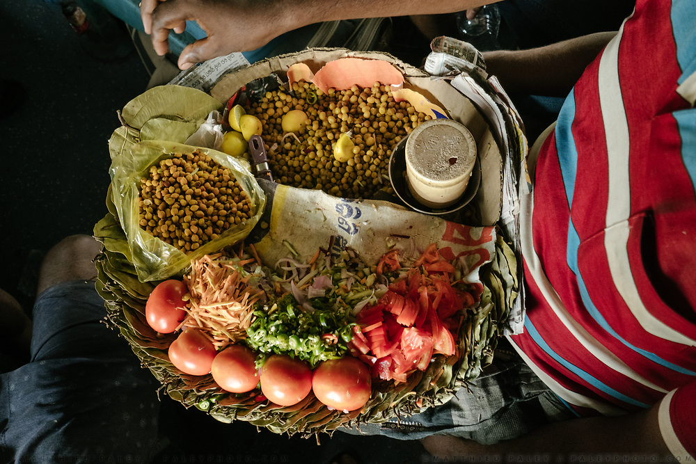 A vendor offers chana masala, a dish made of chickpeas, to anyone willing to pay 20 rupees.<br /> Inside the Dibrugarh-Kanyakumari Vivek Express, the longest train route in the Indian Subcontinent. It joins Kanyakumari, Tamil Nadu, which is the southernmost tip of mainland India to Dibrugarh in Assam province, near the border with Burma.