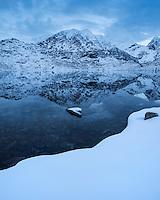 Himmentindan mountain peak reflects in water of lake Vikvatnet, Vestvågøy, Lofoten Islands, Norway