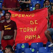 """Roma 14/08/2021 Stadio Olimpico<br /> Amichevole <br /> AS Roma vs Raja Club Athletic<br /> i tifosi in curva con un cartello """"speravo de torna prima"""""""