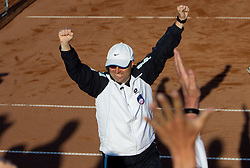 Iztok Bozic, coach of Slovenia celebrates after the doubles against Canada at the second day of the tennis Fed Cup match between Slovenia and Canada at Bonifika, on April 17, 2011 in Koper, Slovenia.  Slovenia won 3-2 and stays in World Group II. (Photo by Vid Ponikvar / Sportida)