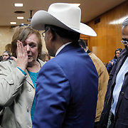 Noemi Sigler cries while talking with retired Texas Ranger Rudy Jaramillo, center, following the guilty verdict in Feit's trial. Sigler, a member of Irene's extended family by marriage, helped keep the case alive with Lynda de la Viña. Jaramillo took over the cold-case in the early 2000s and with the help of McAllen Police Chief Victor Rodriguez, right, believed they had enough to convict Feit. Nathan Lambrecht/The Monitor