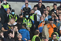 Football - 2021 / 2022 EFL Sky Bet Championship - Cardiff City vs Millwall - Cardiff City Stadium - Saturday 21st August 2021<br /> <br /> Police enter the Milwall supporters area as tempers flare after Cardiff's 3rd goal<br /> <br /> COLORSPORT/WINSTON BYNORTH