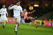 Cedric Soares of Southampton is challenged by Fernando Llorente of Swansea city.  Premier league match, Swansea city v Southampton at the Liberty Stadium in Swansea, South Wales on Tuesday 31st January 2017.<br /> pic by  Andrew Orchard, Andrew Orchard sports photography.