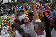 Jose Hernandez looks to the sky while holding hands with friend Victor Bayez as they grieve the loss of friends Amanda Alvear and Mercedez Flores, both recently killed in the mass shooting at Pulse nightclub, during a vigil in Orlando, Florida, U.S. The 49 people killed in the attack on the LGBTQ community were honoured. At the time, it was the deadliest mass shooting in modern U.S. history. It has since been eclipsed.