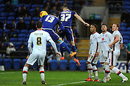 Cardiff City's Tom Lawrence (37) heads at goal. Skybet football league championship match, Cardiff city v MK Dons at the Cardiff city stadium in Cardiff, South Wales on Saturday 6th February 2016.<br /> pic by Carl Robertson, Andrew Orchard sports photography.