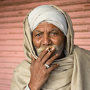 Portrait of Indian man smoking in old town of Jaipur