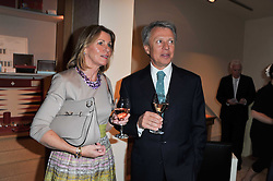 JAMIE & OONAGH BERRY at a party to celebrate the publication of 'Garden' by Randle Siddeley held at Linley, 60 Pimlico Road, London on 24th May 2011.