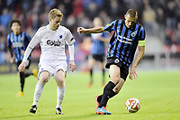 06/11/14 UEFA EUROPA LEAGUE<br /> Timmy Simons of Club Brugge is challenged by Tom Høgli of Copenhagen during the UEFA Europa League group B match between FC København and Club Brugge at the FC Norway only