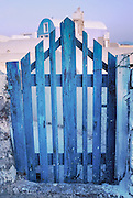 Oia, Santorini Island, Greece: blue gate, wired shut