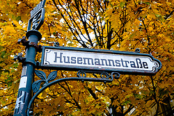 Ornate old street sign at Husemannstrasse in bohemian Prenzlauer Berg during Autumn in Berlin Germany