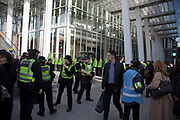 Police block off the entrance to The Shard after London Bridge Station was evacuated due to an abandoned vehicle on 7th March 2017, in London, United Kingdom. The area was cordoned off by police leaving hundreds of people beyond the police cordon. The vehicle had been deemed suspicious by the Metropolitan Police Service, and so the entire area was off limits while the emergency services and bomb squad dealt with the issue.