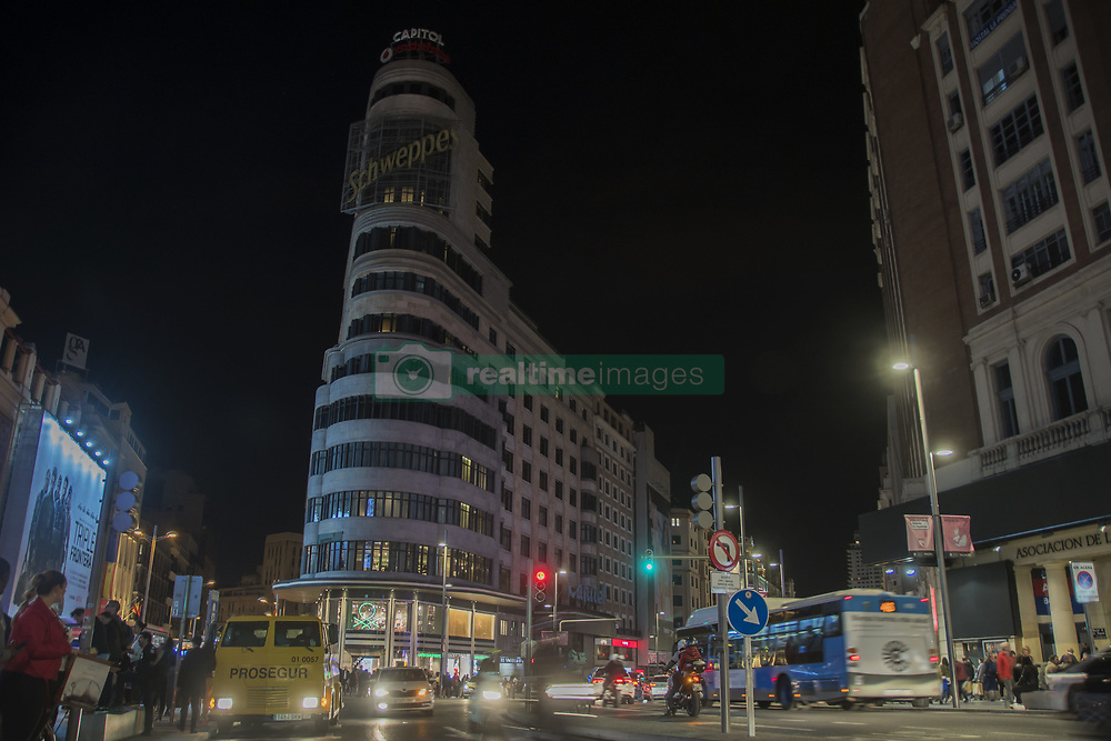 March 30, 2019 - Madrid, Madrid, Spain - The famous building of Gran Via Schweppes seen during the Earth Hour..The most important monuments and buildings in Madrid led a blackout. This was a wake-up call to the political sphere and to citizens for the fight against climate change in the world. It was called the Earth Hour. (Credit Image: © Alberto Sibaja/SOPA Images via ZUMA Wire)