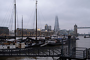Misty evening in Wapping looking over Hermitage Wharf across the River Thames towards Tower Bridge and the Shard on 30th January 2021 in London, United Kingdom.
