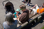 Pike Market park on a summer Sunday. Hipster dad, tattoos on parade, men in capri pants.. a bit of everything.