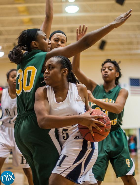 Hickory Ridge's Kiana Davis (5) drives to the basket around Central Cabarrus' Sophia McFarlane (30) Friday night at Hickory Ridge High School in Harrisburg. The Ragin' Bulls won the game 58-52.
