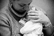 A mother holding her tiny newborn.<br /> Newborns are even smaller, undefended. Parents are unquiet and machines sound their beeps. The most remembered feeling, for who was there on their first or last child, is impotence. Life is an incredible fight in tiny hands.<br /> In MAC, in Lisbon, Portugal, every year 6000 babies are born, about 6% of all country's births. About 150 of newborns in MAC weight less than 1500 grams.<br /> Meanwhile, the fate of the maternity-hospital is suspended as the portuguese economic crisis is pushing the Government to close the oldest working unit in Portugal.