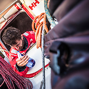 Leg 4, Melbourne to Hong Kong, day 15 on board MAPFRE, Life on board, Louis Sinclair removing the salt from his skin with fresh water after his watch. Photo by Ugo Fonolla/Volvo Ocean Race. 15 January, 2018.