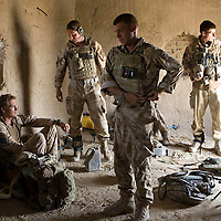 British soldiers of 3rd Battalion The Parachute Regiment on a search for insurgents after a dawn assault on a compound as part of Operation 'Southern Beast'. Kandahar Province, Afghanistan on the 6th of August 2008.