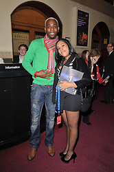 Athlete Phillips Idowu and his girlfriend Carlita at the opening night of Totem by Cirque du Soleil held at The Royal Albert Hall, London on 5th January 2011.
