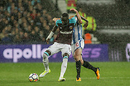 Cheikhou Kouyate of West Ham utd  battles with Aaron Mooy of Huddersfield Town .Premier league match, West Ham Utd v Huddersfield Town at the London Stadium, Queen Elizabeth Olympic Park in London on Monday 11th September 2017.<br /> pic by Kieran Clarke, Andrew Orchard sports photography.