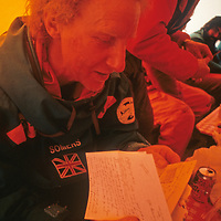Geoff Somers reads mail from home after reaching the South Pole, about halfway through the 1989-1990 Trans-Antarctica Expedition.