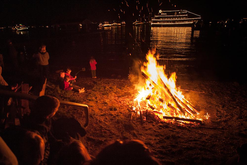 North America, United States, Washington, Bellevue, beach bonfire and annual Christmas Ship Parade