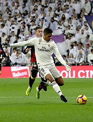 MADRID, Dec. 16, 2018  Real Madrid's Raphael Varane passes the ball during a Spanish league match between Real Madrid and Rayo Vallecano in Madrid, Spain, on December 15, 2018. Real Madrid won 1-0. (Credit Image: © Edward F. Peters/Xinhua via ZUMA Wire)