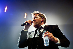 Lead vocalist and lyricist Guy Garvey Elbow at Sheffield Motorpoint Arena  .19 March 2011.Images © Paul David Drabble