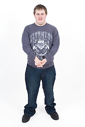 Portrait of a teenage boy with Downs Syndrome,
