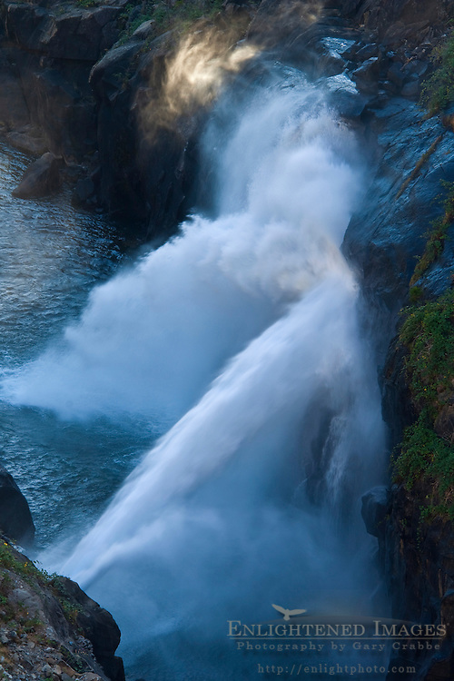 Powerful water streaming from outlet pipes from the dam at Hetch Hetchy Reservoir into the Tuolumne River, Yosemite National Park, California