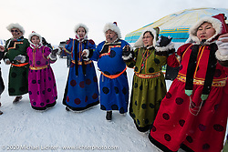 Buryatians in indigenous dress from this region of Siberia performed at the Baikal Mile Ice Speed Festival. Maksimiha, Siberia, Russia. Thursday, February 27, 2020. Photography ©2020 Michael Lichter.