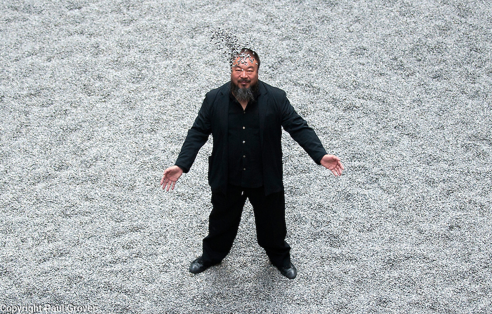 Mcc0026331.DTNews.Tate Modern,The Unilever Series,'Sunflower Seeds' by Chinese Artist Ai Weiwei.The installation a flat landscape of over 100 million porcelain replica sunflower seeds.Pic Shows Ai Weiwei with his artwork