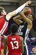 Former Richland forward Leyton Hammonds #25 draws a foul from former San Antonio Reagan forward D.J. MacLeay #0 during the 2013 THSCA All-Star Basketball Game at Daniel - Meyer Coliseum in Fort Worth on Monday, July 29, 2013. (Cooper Neill/Special Contributor)