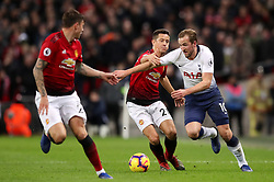 Manchester United's Ander Herrera (centre) pulls back on Tottenham Hotspur's Harry Kane (right)