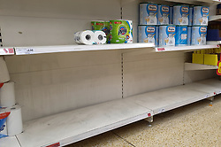 © Licensed to London News Pictures. 20/09/2021. London, UK. Nearly empty shelves of toilet rolls in Sainsbury's in north London as fears of food shortages grow after two of the UK's biggest Carbon Dioxide (CO2) producers halted production last week due to soaring gas prices. Photo credit: Dinendra Haria/LNP