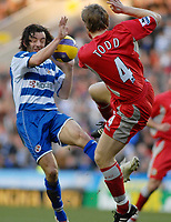 Photo: Gareth Davies.<br />Reading v Blackburn Rovers. The Barclays Premiership. 16/12/2006.<br />Reading's Steven Hunt (L) and Blackburn's Andy Todd (R) challenge for the ball in the air.