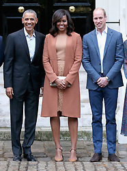 (Left to right) The President and First Lady of the United States Barack Obama and his wife Michelle, and the Duke of Cambridge, pose for a photo in Clock Court, at Kensington Palace in London, as they arrive ahead of a private dinner hosted by the Royal couple in their official residence at the palace.