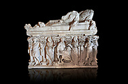 Roman sarcophagus with relief sculptures from Hierapolis . Hierapolis Archaeology Museum, Turkey<br /> <br /> Columned Sarcophagus Sarcopinagu of Euthios Pyrrnon, Asian Archon (ruler), Roman Period First quarter of third century A.D. Loadicea. <br />  <br /> Four sides of these sarcophagi are all in relief. They appear like a columned temple. The reliefs between the grooved columns are related to the private life of the individual. His/her education, heroic scenes and plant or mythological motifs are decorated in relief. The cover of the sarcophagus is arranged like a bed and it is depicted as the wife and the husband as lying on it. The name of the individual and some mythological reliefs are found in the surrounding of the cover. The two sarcophagi in the hall are of this kind. . Against an black background .<br /> <br /> If you prefer to buy from our ALAMY STOCK LIBRARY page at https://www.alamy.com/portfolio/paul-williams-funkystock/greco-roman-sculptures.html- Type - Hierapolis - into LOWER SEARCH WITHIN GALLERY box - Refine search by adding a subject, place, background colour, museum etc.<br /> <br /> Visit our CLASSICAL WORLD HISTORIC SITES PHOTO COLLECTIONS for more photos to download or buy as wall art prints https://funkystock.photoshelter.com/gallery-collection/The-Romans-Art-Artefacts-Antiquities-Historic-Sites-Pictures-Images/C0000r2uLJJo9_s0c