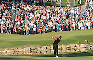 Tiger Woods hits his approach shot on hole 18 during Round 4 of the 2011 Chevron World Challenge at the Sherwood Country Club in Thousand Oaks, Calif., on Sunday, Dec. 4, 2011.