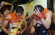 Lachie Plowman of the Giants and Josh Hunt of the Giants are sprayed with drink after the 2014 AFL round 03 match between the GWS Giants and the Melbourne Demons at Spotless Stadium, Sydney on April 06, 2014. (Photo: Craig Golding/AFL Media)