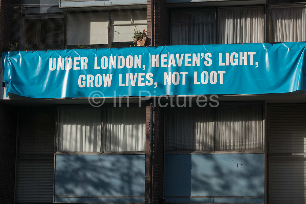 A banner on the balcony of a flat in Bowater House on the Golden Lane Estate protests about the 10-storey luxury apartment development called The Denizen, a controversial building by Taylor Wimpey that locals say will dominate their view and block their daylight, on 30th October 2017, in London, England. Residents on the Estate have erected banners by artists Jeremy Deller and Elizabeth Price to picket the developers. Despite this, Wimpey say, We are one of the UKs largest residential developers. As a responsible developer we are committed to working with local people and communities.