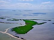 Nederland, Flevoland, Markermeer, 07-05-2021; Trintelzand, nieuw aangelegd natuurgebied gelegen tegen de westelijke zijde van de Houtribdijk. Het gebied ligt tussen tussen de vluchthaven Trintelhaven en Enkhuizen. Marker Wadden in de achtergrond. Moerasgebied voor vogels en vissen, met zandplaten, slikvelden en rietoevers. Het Trintelzand wordt gerealiseerd binnen het project Versterking Houtribdijk, en is onderdeel van het Nationaal Park Nieuw Land<br /> Trintelzand, newly constructed nature reserve next to the Houtribdijk. Marsh area for birds and fish, with sandbanks, mudflats and reed banks.<br /> luchtfoto (toeslag op standard tarieven);<br /> aerial photo (additional fee required)<br /> copyright © 2021 foto/photo Siebe Swart